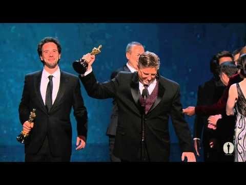 "The Avengers cast--Robert Downey Jr., Chris Evans, Samuel L. Jackson, Jeremy Renner and Mark Ruffalo--presenting Bill Westenhofer, Guillaume Rocheron, Erik-Jan De Boer and Donald R. Elliott with the Oscar® for Best Visual Effects for ""Life of Pi"" at the 2013 Oscars®."