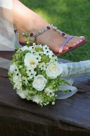 Romantikus esküvői csokor pasztell színű virágokból