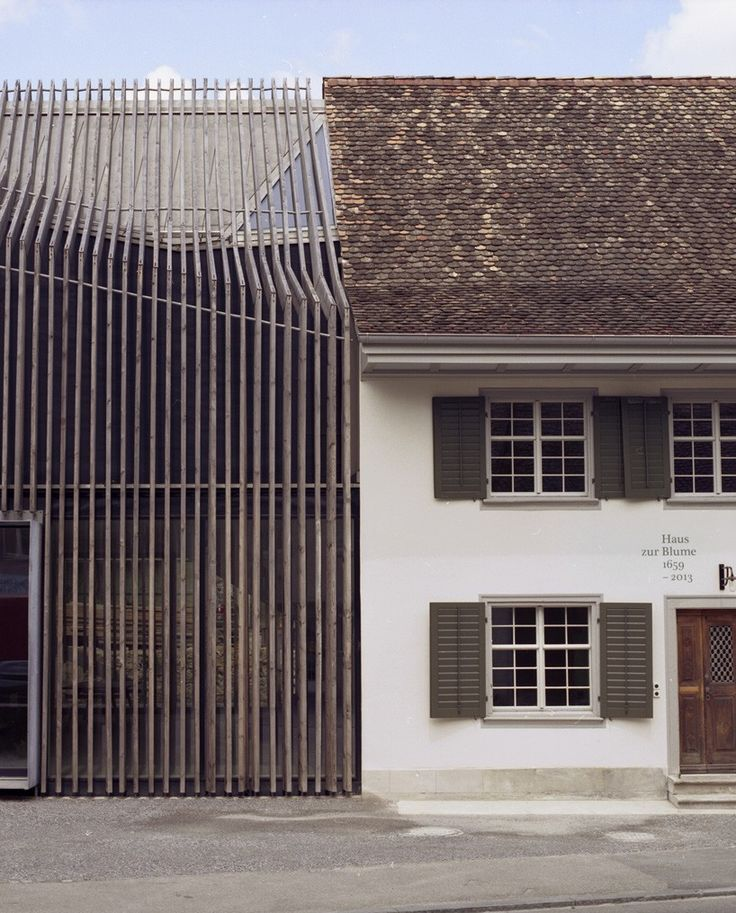 marazzi reinhardt slots farmhouse intervention between traditional swiss buildings