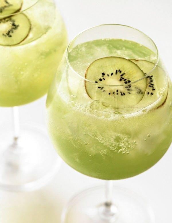 Kiwi Cocktail  ,2 parts Flavored Vodka 1 part simple syrup 1 kiwi fruit peeled and quartered 1 sprig of mint 1 inch piece of vanilla pod Splash of club soda