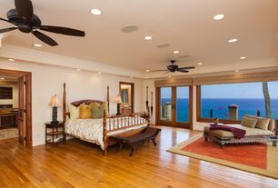 Tropical Master Bedroom with Carpet, Ceiling fan, High ceiling, Hardwood floors, Crown molding