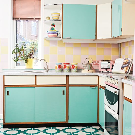 Retro kitchen with vinyl floor and turquoise cabinetry