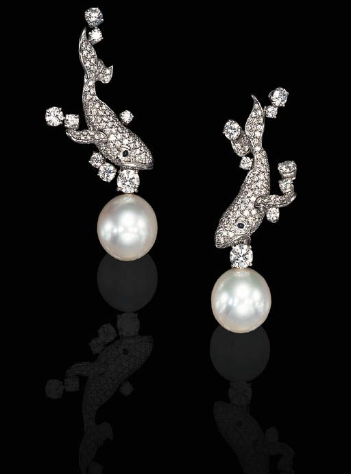 THE PINES OF ROME, COMPOSED BY OTTORINI RESPIGHI   A PAIR OF DIAMOND AND SOUTH SEA PEARL EAR PENDANTS, BY MIKIMOTO  Each designed as a pavé-set diamond whale, enhanced by cabochon sapphire eyes and circular-cut diamond 'bubbles,' suspending a cultured south sea pearl measuring approximately 16.90 mm, mounted in platinum, in its original Mikimoto fitted red leather box  Signed Mikimoto  Signed Disney