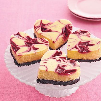 Raspberry-White Chocolate Cheesecake Bars  Heart-shaped cheesecakes are the way to show that special someone your love this Valentine's Day, but they're also delicious the rest of the year. Bake a batch to celebrate your sweetie today.