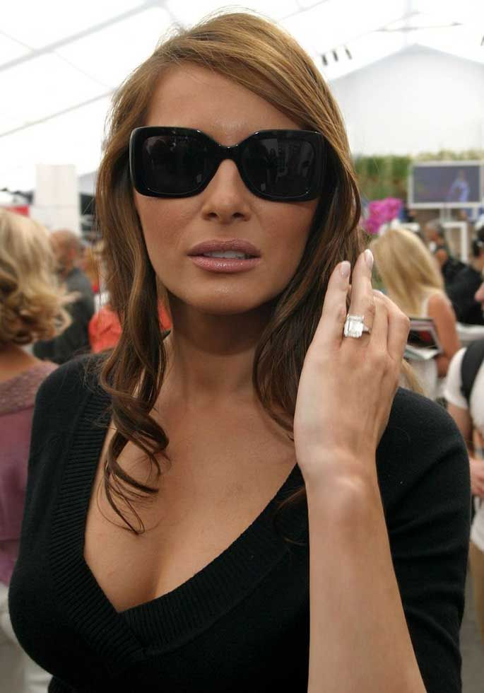 Melania showing her expensive ring to the camera.