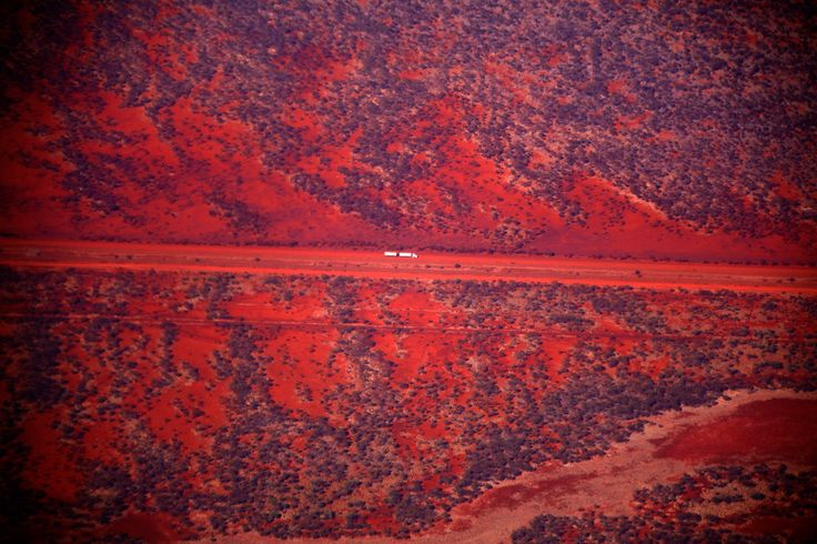 A truck drives along a road in the Pilbara region of Western Australia December 2, 2013. Western Australia's Pilbara region, which is the size of Spain, has the world's largest known deposits of iron ore and supplies nearly 45 percent of global trade in the mineral. Picture taken December 2.   REUTERS/David Gray     (AUSTRALIA - Tags: ENVIRONMENT BUSINESS TRANSPORT) - RTX161JA