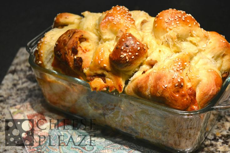 Sausage Cheddar Cheese Loaf topped with Sesame seeds. Just out of the over, melts in your mouth delicious.