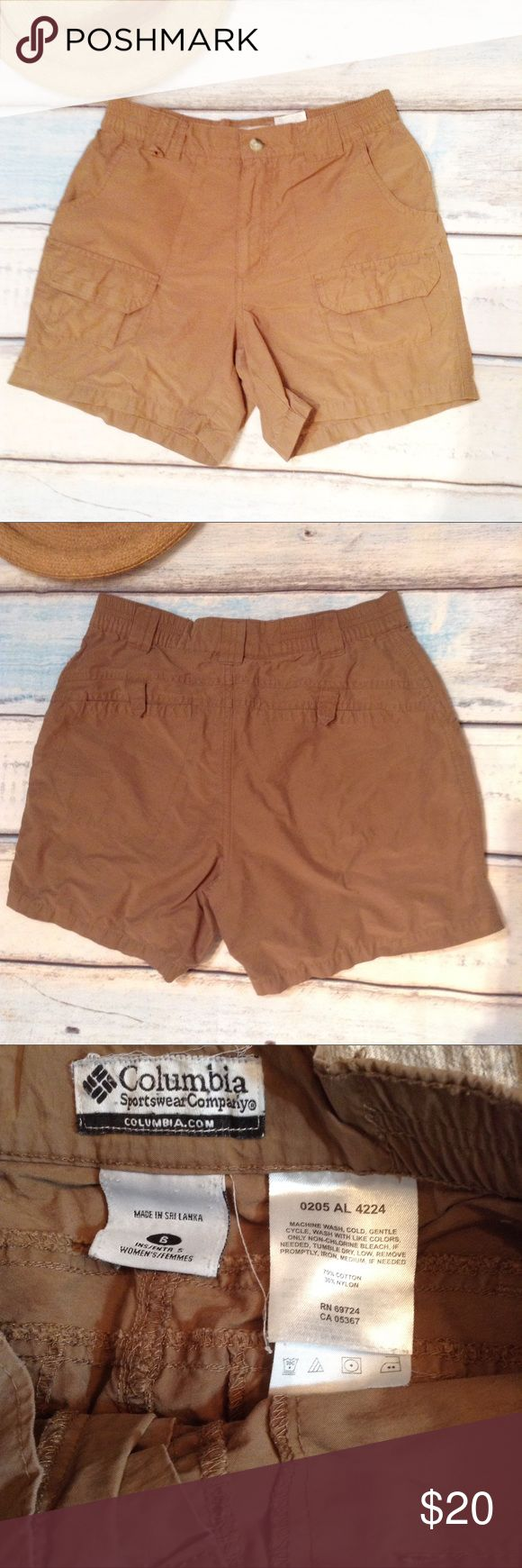 "COLUMBIA Sportswear Khaki Camping Hiking Shorts Columbia Sportswear Company dark khaki camping hiking shorts. Size 6. Elastic in the waist. Measures 13.5"" flat and unstretched at waist, 10"" front rise, and 4.5"" inseam. No modeling. Smoke free home. I do discount bundles. Columbia Shorts"