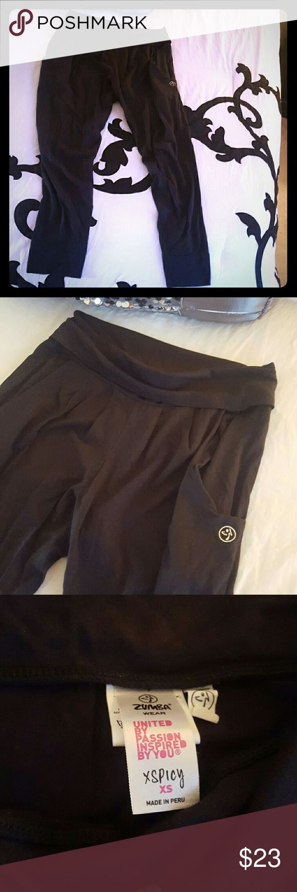 Black harlem Zumba pants Black harlem Zumba pants with pockets. Can be worn as pants or hike up as capri length. Only worn a couple times. Fits size 4. Zumba Pants