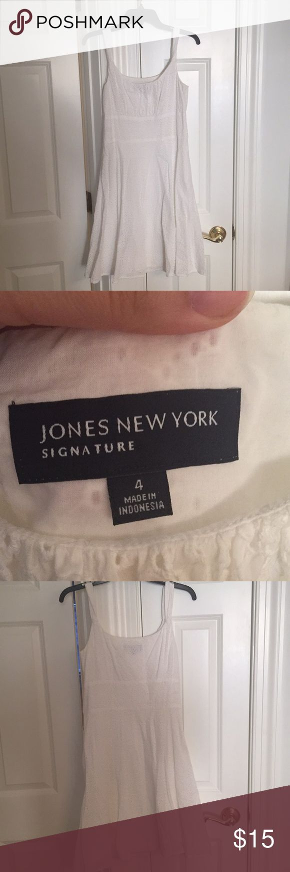 Fully lined white eyelet sundress from Jones NY This is a flattering, fully lined white eyelet sundress from Jones New York. Very pretty fabric and not see through. Worn a few times but in great condition. Size 4. Jones New York Dresses