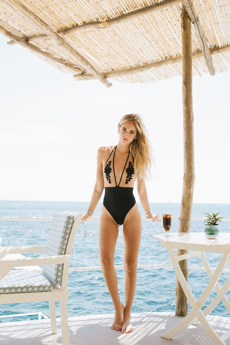 Chiara wearing a Calzedonia one piece swimsuit, decorated with tulle and floral patches