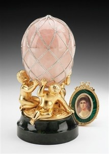 FABERGÉ eggs__ Diamond Trellis Egg on its stand. The 3 cherubs at the base are said to represent the sons (Nicholas, George, Michael) of Alexander III and his wife, Empress Maria Feodorovna. A 4th son, Alexander, died in infancy at 11 months old.