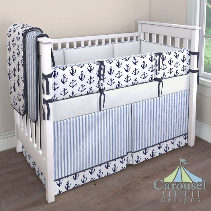 Nautical Crib bedding in Solid Navy, Ocean Blue Ticking Stripe, Windsor Navy Anchors, Solid Antique White. Created using the Nursery Designer® by Carousel Designs where you mix and match from hundreds of fabrics to create your own unique baby bedding. #carouseldesigns