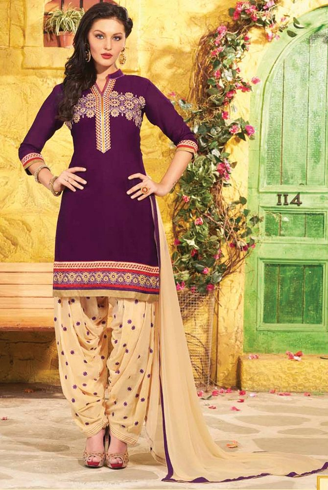 Byzantium Purple Patiala Style Salwar Kameez has floral embroidered front & edge of Top with embroidered Bottom giving a Party wear look. Available Sizes: 38,40,42 Fabric: T-Pure Cotton, B-Santoon, D-Chiffon Colour: T-Purple, B-Beige, D-Beige