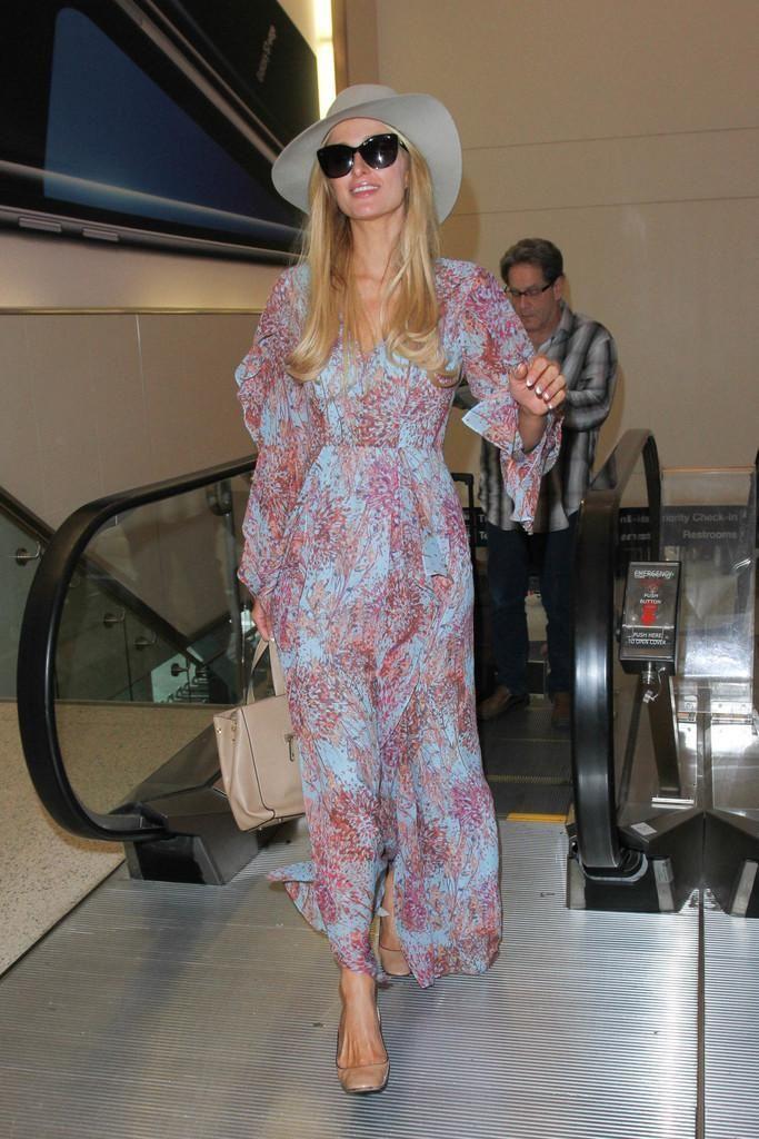 Paris Hilton wearing Dolce & Gabbana Rose Cat Eye Sunglasses and Prada Nude Pumps