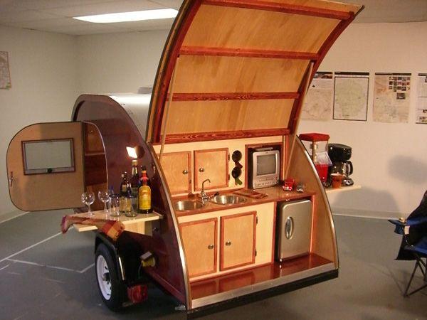 A deluxe woody teardrop camper. Cool!