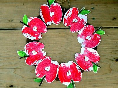 Apple craft: Apples made by printing with a real cut apple.  Cute apple wreath.