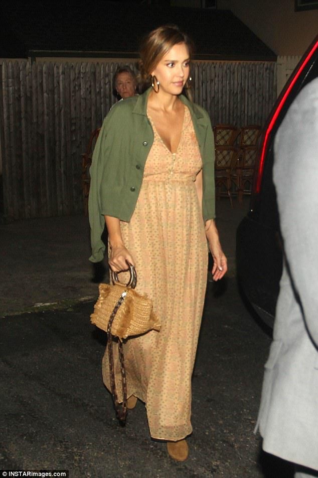Country vibes: Jessica Alba clutched a straw purse with her tan dress for dinner in The Hamptons on Saturday night