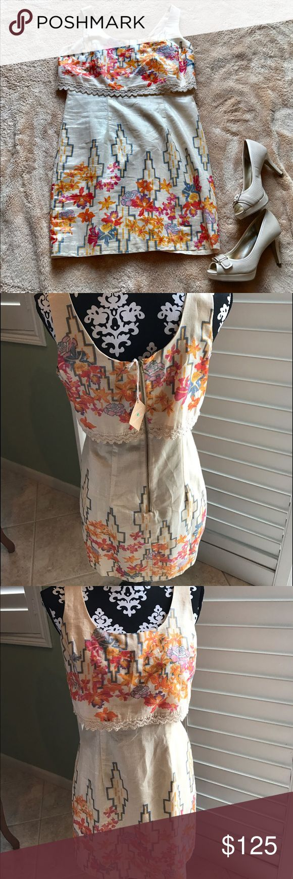 Free People Gold Metallic Aztec Floral Dress NWT Brand new never worn.  Free People Gold Metallic Aztec Floral Shift Dress Boho Hippie dress perfect for spring can be dressed up or down perfect for any occasion Free People Dresses Midi