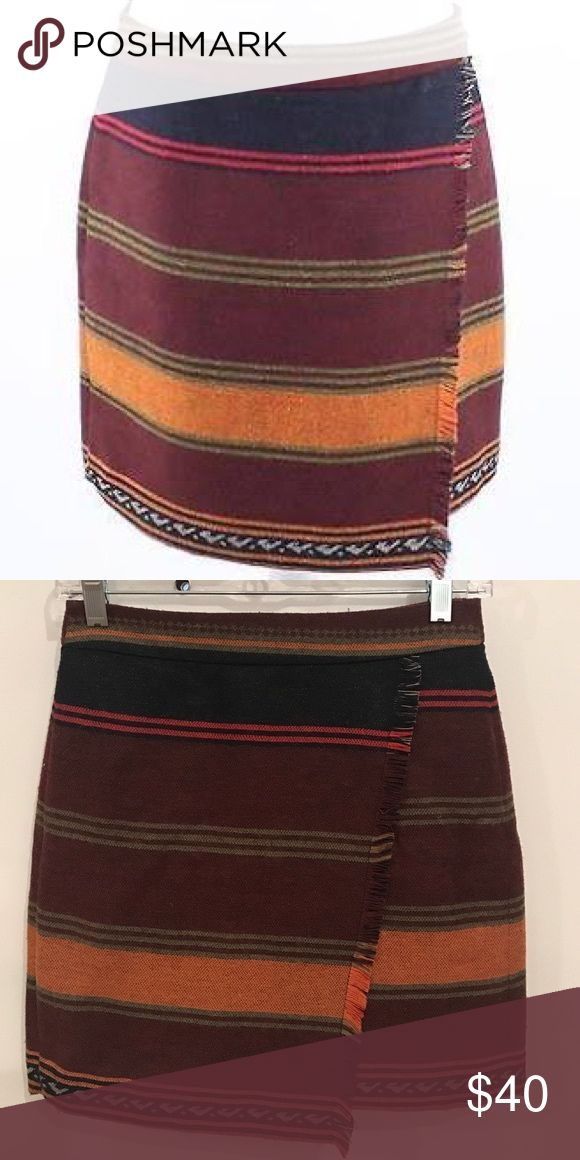 ANNE TAYLOR LOFT Raw Hem Wrap Fringe Skirt ANNE TAYLOR LOFT Raw Hem Wrap Fringe Skirt. The skirt is fully lined and a wool blend. Perfect with black leggings and flats for the fall. LOFT Skirts