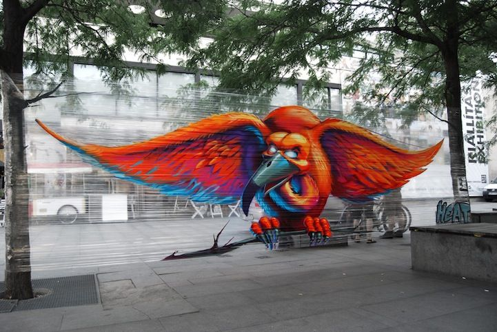 Street Artist Paints Flying Bird on Stretched Cellophane   – aRT