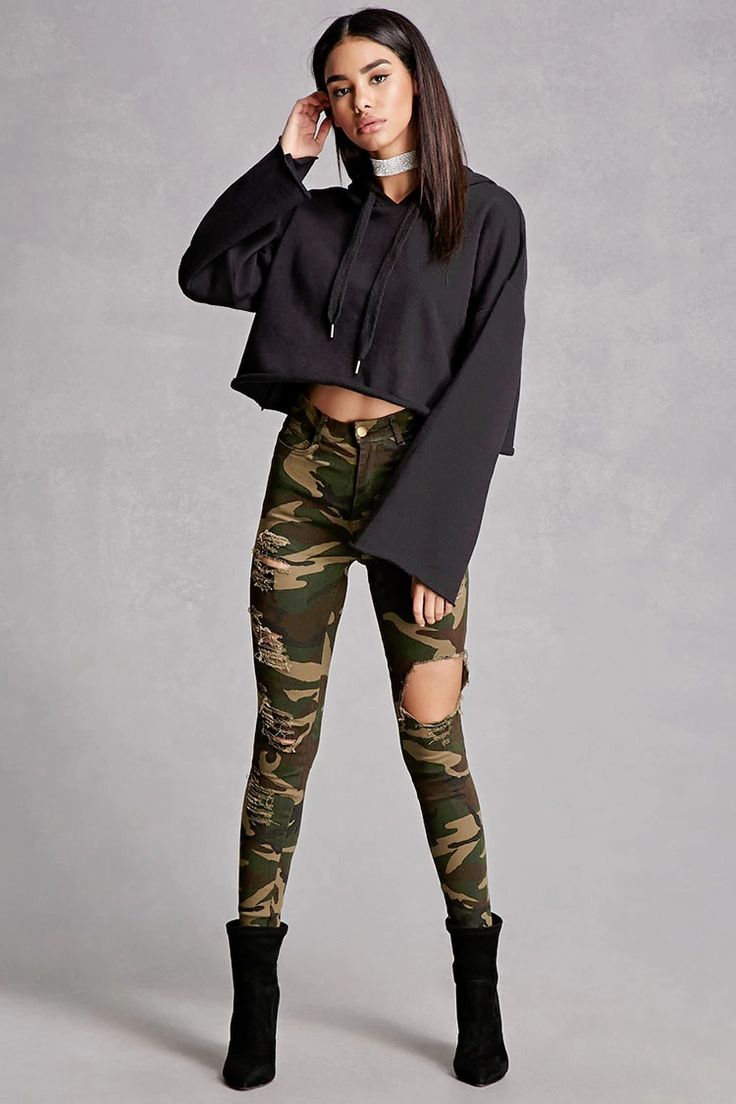 A pair of skinny jeans featuring a camo print, distressed design, high-rise fit, a five-pocket construction, and a zip fly. This is an independent brand and not a Forever 21 branded item.