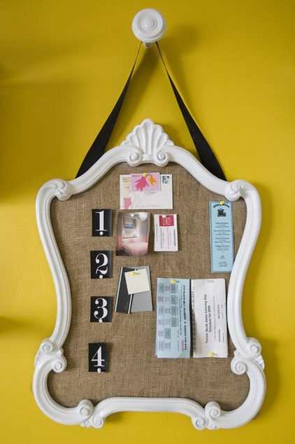 DIY ~ Make your own bulletin board by replacing an old mirror with the board, repaint the frame and attach your hanging ribbon