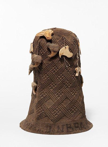 Prestige Cap (Mpu) 19th century Geography: Democratic Republic of the Congo; Cabinda, Angola; Republic of the Congo Culture: Kongo peoples Medium: Raffia or pineapple fiber, leopard claws, bone