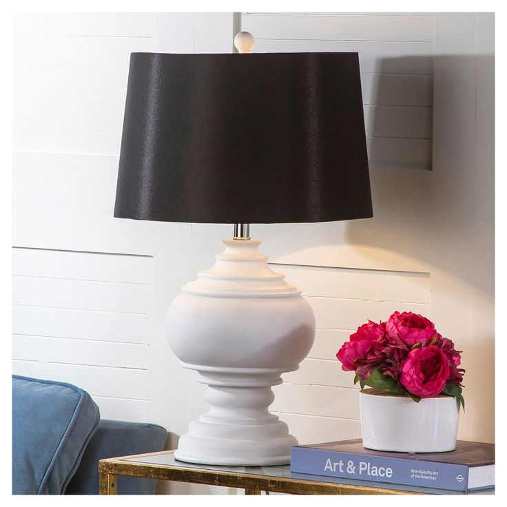 A classic urn shape defines the elegant white Callaway table lamp as the ideal accessory for the new traditional trend in decorating. With its beautifully turned base, black cotton drum shade and acrylic finial, it works equally well in traditional rooms.