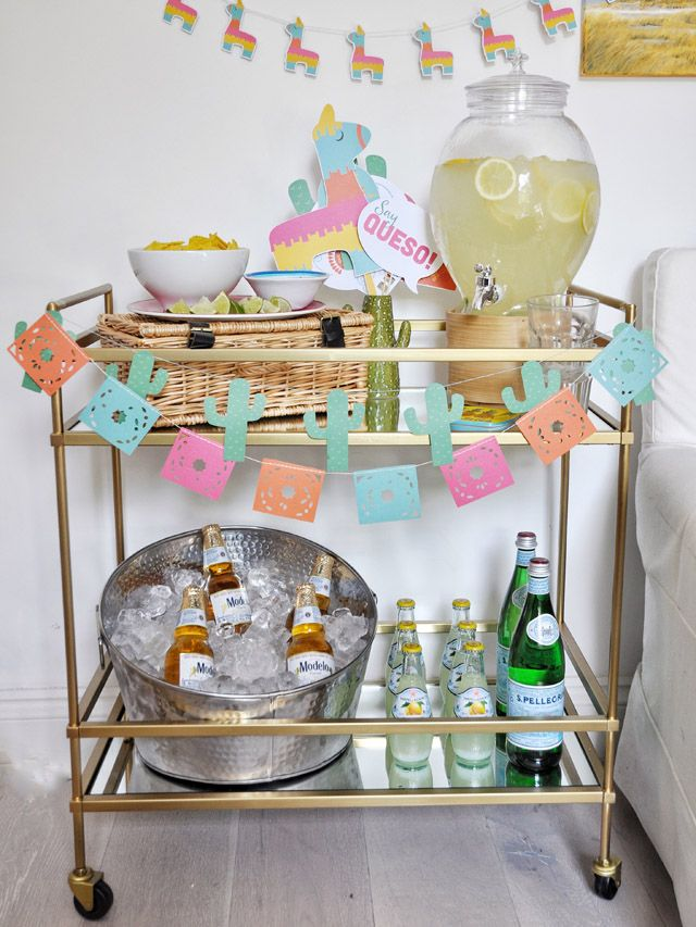 Bar Cart Style for taco tuesday home decor complete with margarita dispenser and beer cooler!