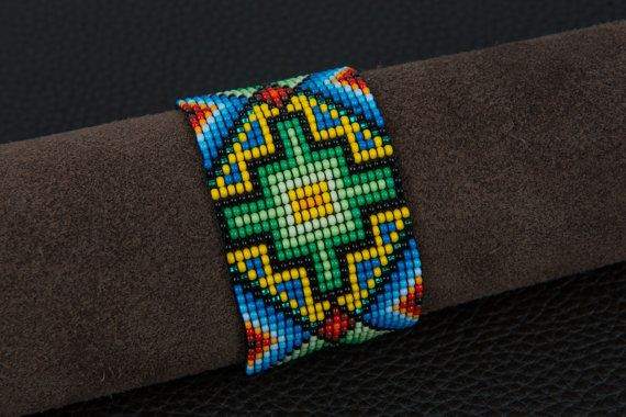 The Chacana Cross Bracelet in Mother Nature shows a fiery Chacana or Incan cross, also known as the Tree of Life. The cross represents the four directions and the square shows the spirit world of the gods and the underworld of our ancestors. At the center of the cross is the portal to access these cosmic realms. It is also a symbol for the indigenous people of South America. Part of a unique range of ethical handmade jewelry from Colombia. A limited few are available in our Etsy shop.