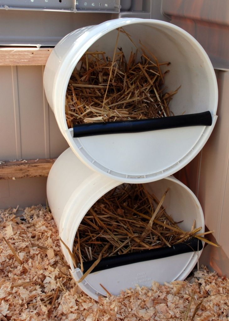 5 gallon bucket chicken nesting box - another great repurposing idea!