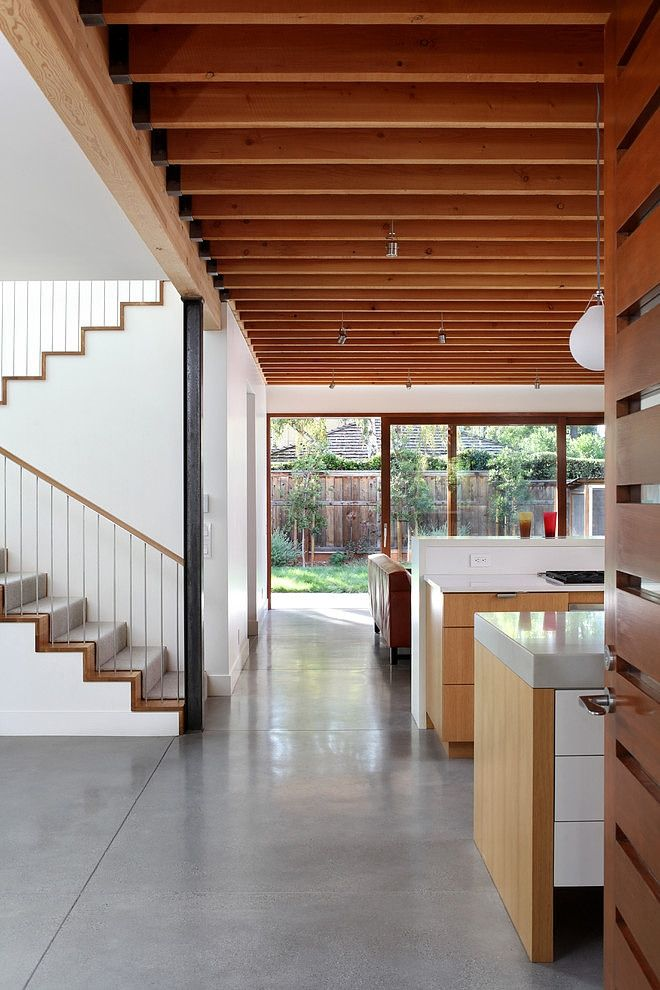 EXPOSED BEAMS WITH BLACK HANGERS Palo Alto House by Arcanum Architecture