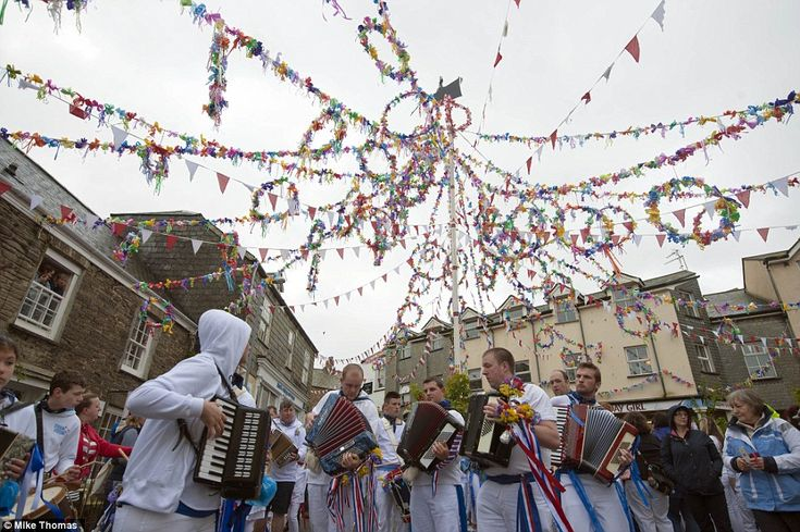 Maypole: Padstoe.  Two 'osses dance around the Cornish village with locals wearing red or blue depending on which colour 'oss they support.