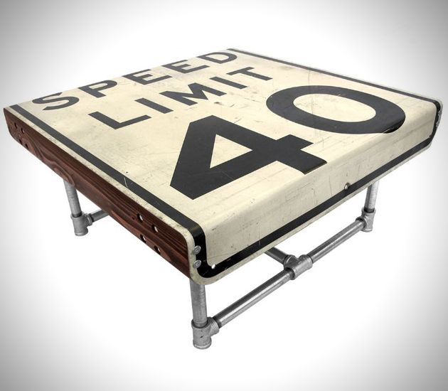 Street Sign Furniture by Tim Delger  The artist describes the collection as functional art due to the fact that each and every repurposed highway sign turned furniture was crafted by hand, and each has its own texture and personality. There are tons of different signs being used for both tables and chairs in the Street Sign Furniture Collection.