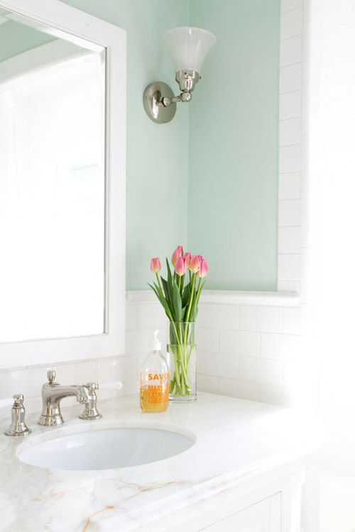 Bathroom with clean bright colors subway tile large bathroom mirror