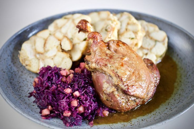 sous vide leg of duck served with dumplings and fragrant red cabbage with apples