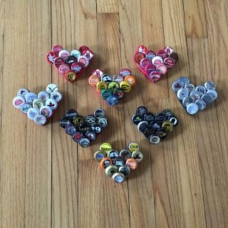 """A heart. Made out of beer bottle caps. Whaaatt!?  If they are anything like the crabs they won't be around for long ... so order up! Think you may prefer a CRAB made outta bottle caps? Click HERE. to see...  Cheers to these fun 4.5"""" x 4.5"""" (ish) magnets made with LOVE by The Drift Shop!"""