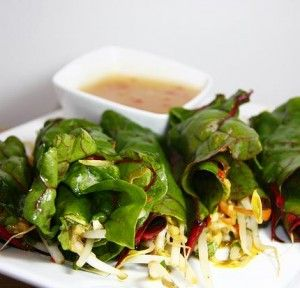 Raw Spring Rolls / This dish is much fresher and healthier than the more popular deep fried roll. These are wrapped in collard leaves and filled with fresh, crunchy veggies in a spicy, flavorful marinade. - Must try these with these amazing Pineapple-Chilli Dipping Sauce recipe and Raw Almond Dipping Sauce