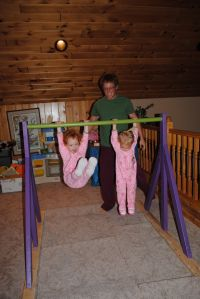 homemade gymnastics bar.  Visit pinterest.com/arktherapeutic for more #grossmotor ideas
