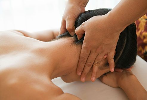 Woman getting neck massage, great for tension headaches.