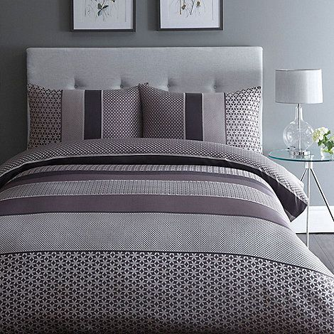 From The Collection, this stylish duvet and matching pillow bedding set comes in purple, grey and black with a horizontal block stripe and pretty jacquard star design.