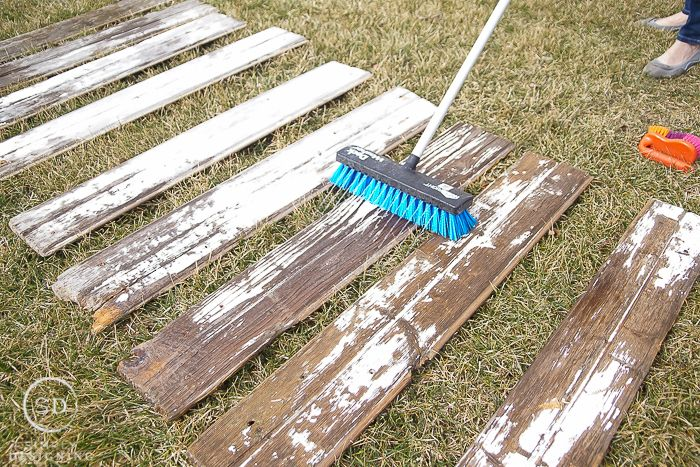 Reclaimed wood is beautiful but it is often dirty and full of bugs. So I am sharing my tips and tricks for How to Clean Barn Wood before you use it inside.