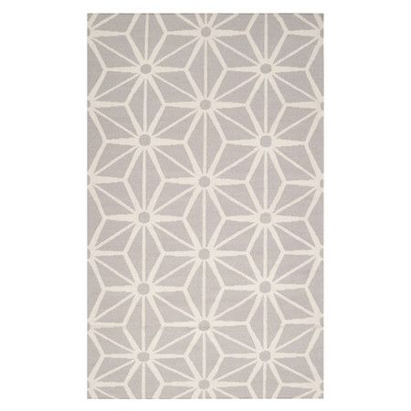 Flatweave wool rug with a geometric motif. Handmade in India.   Product: RugConstruction Material: 100% Wool