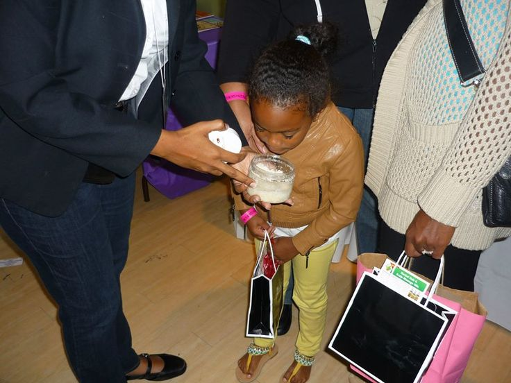 Getting the young customers hooked on body scrubs from early! — at Toronto Natural Hair Show .