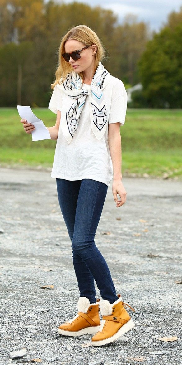 Kate Bosworth goes casual in jeans, tshirt, and the coolest shearling boots to pop up for fall.