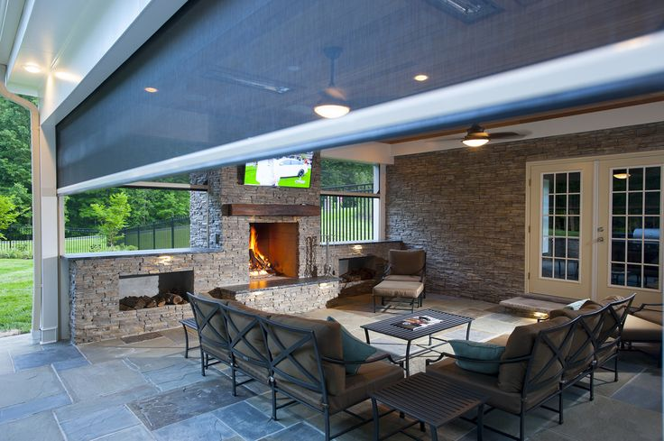 Features include: -  Recessed hot tub -  Flagstone patio and a curved retaining wall -  Infratech infrared heaters -  Phantom motorized retractable screens
