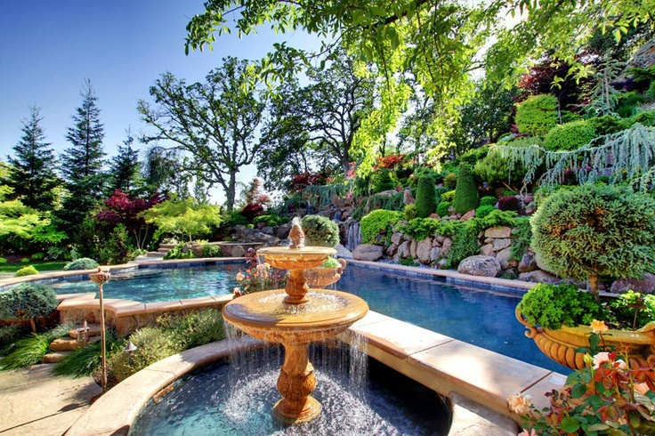 Beautiful backyard with tuscan touches and fountain for Pool design magazine