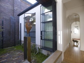 A central courtyard, between the old and new, provides winter sun to otherwise south facing living areas