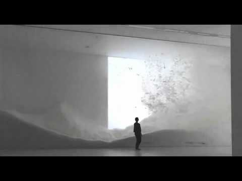 SNOW by Tokujin Yoshioka. A dynamic 15-meter-wide installation. It consists of a scene depicting hundreds of kilograms of light feathers blowing all over and falling down slowly and is meant to remind us of the snow scape of our memories and the beauty of nature which often exceeds our imagination.